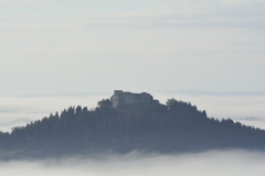 Castello di Montegiove in the mist as seen from Greppolischieto